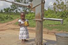 Girl at water pump East Gonja