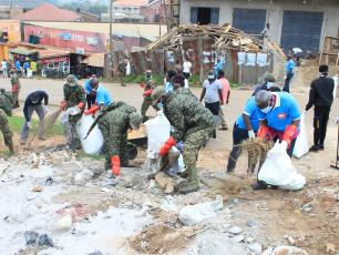 Various stakeholders do a clean-up exercise in Fort Portal, Uganda