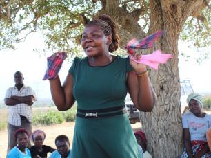 Bulandina Tatu demonstrates the making of reusable menstrual pads by women in Batani village, Kwale County, Kenya
