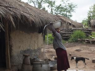 Putting water in vessels in near home in rural Ghana