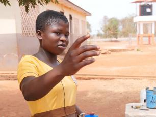 Kenyasi schoolgirl explaining the benefits of water